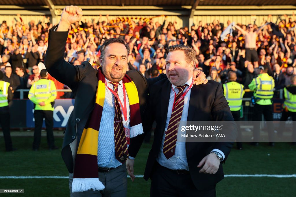 Bradford City co-owners and joint-chairmen Edin Rahic (left) and Stefan Rupp celebrate victory in the Sky Bet League One Playoff Semi Final: First Leg match between Fleetwood Town and Bradford City at Highbury Stadium on May 7, 2017 in Fleetwood, England.