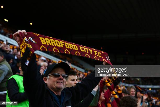 Bradford City fan holds up a scarf during the Sky Bet League One Playoff Semi Final First Leg match between Bradford City and Fleetwood Town at Coral...