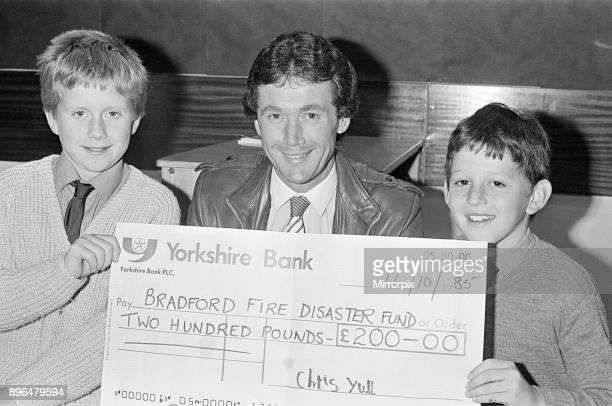 Bradford City football manager Trevor Cherry a former Huddersfield town player who lives at Lepton is presented with a ú200 cheque for the fire...