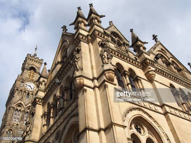 bradford city hall in west yorkshire a victorian gothic building with statues and clock tower - bradford england stock pictures, royalty-free photos & images