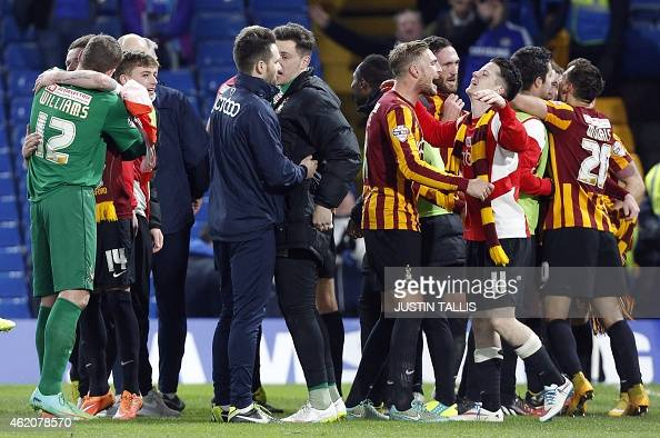 Bradford City players celebrate after the final whistle of ...