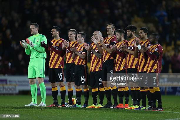 Bradford City players ovserve a minutes applause in honour of former player Bobby Campbell during the Sky Bet League One match between Bradford City...