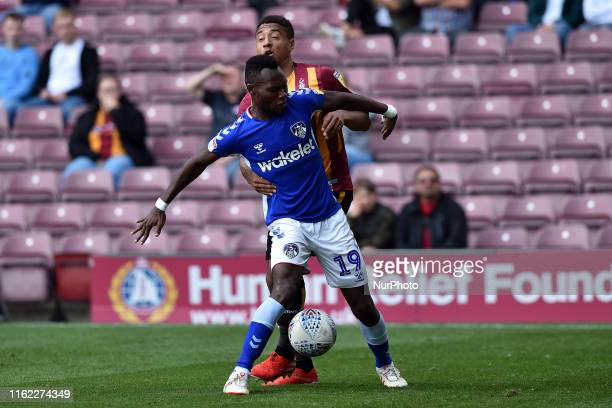 Bradford City's Adam Henley and Oldham Athletic's Desire Segbi Azankpo in action during the Sky Bet League 2 match between Bradford City and Oldham...
