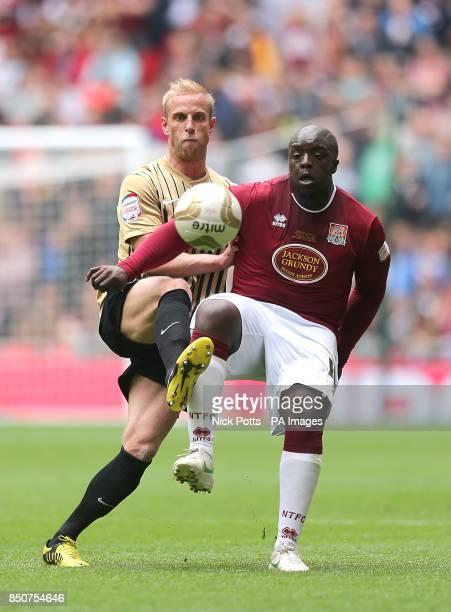 Bradford City's Andrew Davies and Northampton Town's Adebayo Akinfenwa battle for the ball