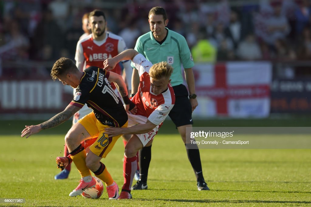 Bradford City's Billy Clarke battles with Fleetwood Town's Kyle Dempsey during the Sky Bet League One Play-Off Semi-Final Second Leg match between Fleetwood Town and Bradford City at Highbury Stadium on May 7, 2017 in Fleetwood, England.