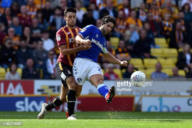 Bradford City's Danny Devine and Oldham Athletic's Zak Mills in action during the Sky Bet League 2 match between Bradford City and Oldham Athletic at...
