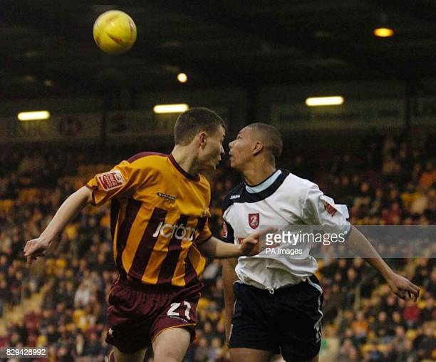 Bradford City's Danny Forrest in action against Walsall's Julian Bennett during the CocaCola League One match at Valley Parade THIS PICTURE CAN ONLY...