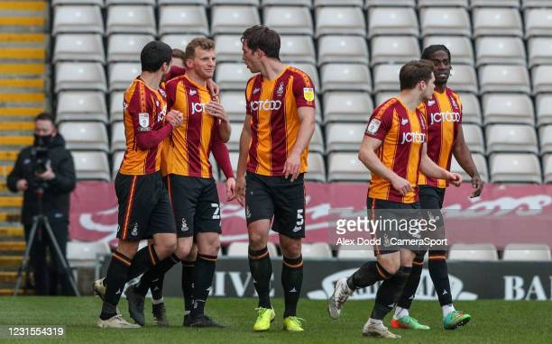 Bradford City's Danny Rowe celebrates scoring a very late equaliser with teammates during the Sky Bet League Two match between Bradford City and...