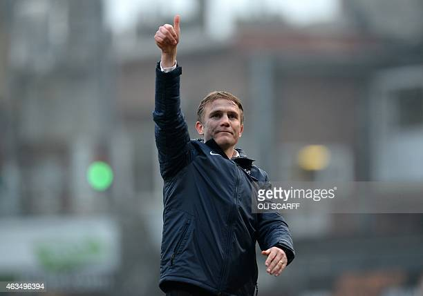 Bradford City's English manager Phil Parkinson gestures to the supporters after the FA Cup fifth round football match between Bradford City and...