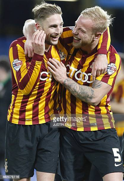 Bradford City's English midfielder Gary Liddle and Bradford City's English defender Andrew Davies celebrate winning 42 at the final whistle during...