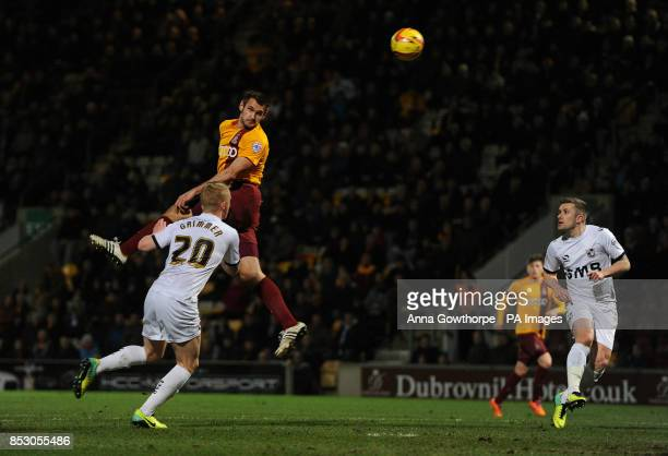 Bradford City's James Hanson has a header on goal under pressure from Port Vale's Jack Grimmer during the Sky Bet League One match at the Coral...