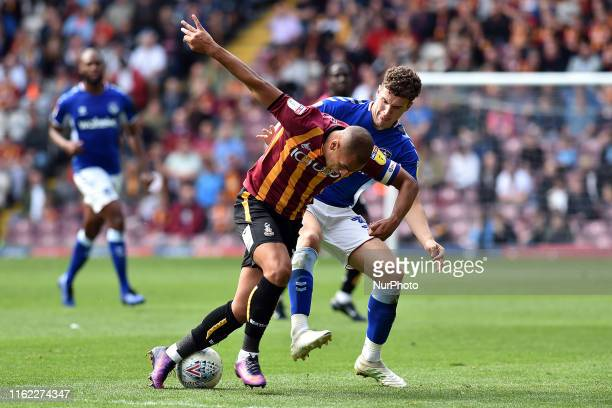 Bradford City's James Vaughan and Oldham Athletic's Alex Iacovitti in action during the Sky Bet League 2 match between Bradford City and Oldham...