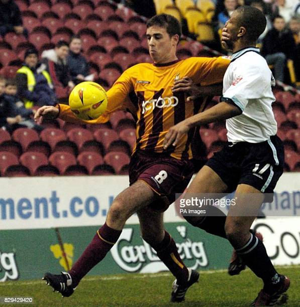 Bradford City's Michael Symes holds off Walsall's Julian Bennett from the ball during the CocaCola League One match at Valley Parade Bradford...