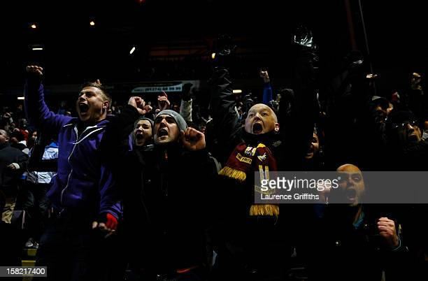 Bradford fans celebrate after Garry Thompson of Bradford scores the opening goal during the Capital One Cup quarter final match between Bradford City...