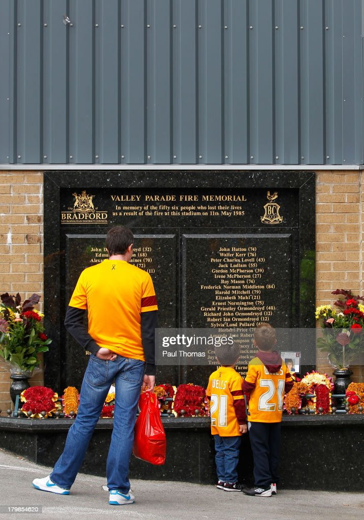Bradford fans read the Valley Parade Fire Memorial before the Sky Bet League One match between Bradford City and Brentford at the Coral Windows Stadium on September 7, 2013 in Bradford, England.