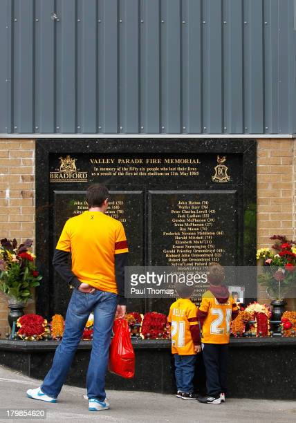 Bradford fans read the Valley Parade Fire Memorial before the Sky Bet League One match between Bradford City and Brentford at the Coral Windows...
