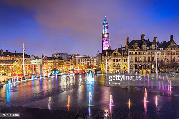 bradford town hall and centenary square at night - town hall stock photos and pictures
