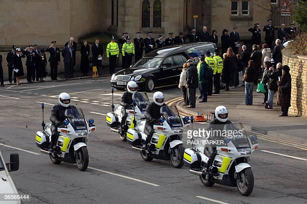 The hearse of murdered police officer Sharon Beshenivsky leaves Bradford Cathedral after her funeral 11 January 2006 under police escort Beshenivsky...