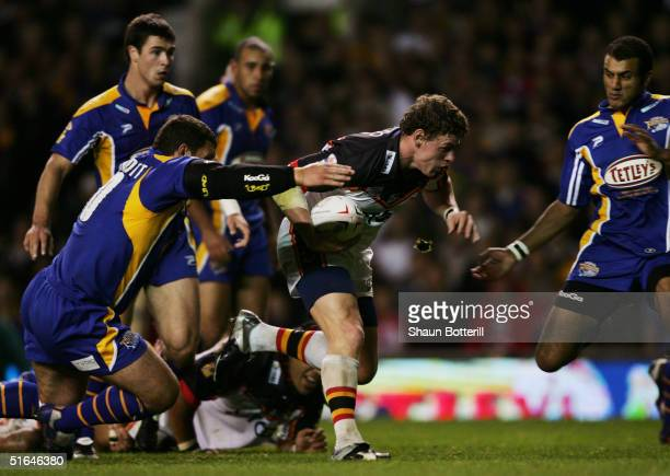 Bradford's Lee Radford is tackled by Barry McDermott of Leeds during the Tetley's Super League Grand Final between Bradford Bulls and Leeds Rhinos at...
