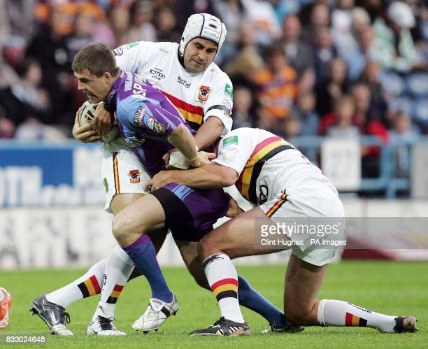 Bradford's Marcus St Hilaire and Glenn Morrison hold up Huddersfield's Martin Aspinwall during the engage Super League match at the Galpharm Stadium...