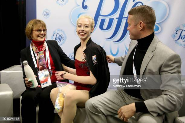 Bradie Tennell celebrates in the kiss and cry with her coach Denise Myers and choreographer Scott Brown after skating in the Ladies Short Program...