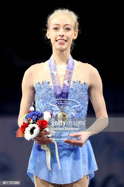 Bradie Tennell celebrates on the medals podium after winning the Championship Ladies during the 2018 Prudential US Figure Skating Championships at...