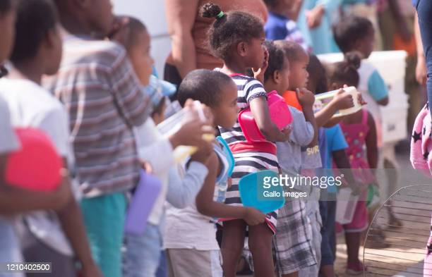 Bradley and his wife LeeAnn Solomons feed children and adults during lockdown in Hillview near Lavender Hill on April 17 2020 in Cape Town South...