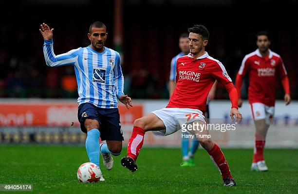 Bradley Barry of Swindon Town is tackled by Marcus Tudgay of Coventry City during the Sky Bet League One match between Swindon Town and Coventry City...