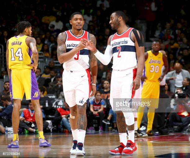 Bradley Beal and John Wall of the Washington Wizards high five during the game against the Los Angeles Lakers on November 9 2017 at Capital One Arena...