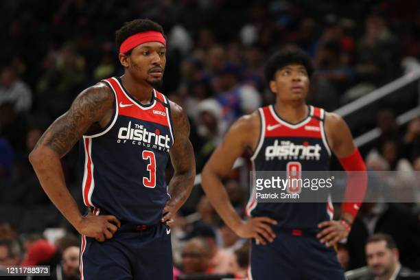Bradley Beal and Rui Hachimura of the Washington Wizards look on against the New York Knicks during the first half at Capital One Arena on March 10...