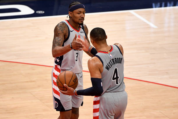 Bradley Beal and Russell Westbrook of the Washington Wizards celebrate after defeating the Charlotte Hornets at Capital One Arena on May 16, 2021 in...