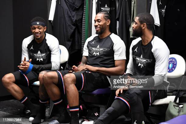 Bradley Beal Kawhi Leonard and Kyrie Irving of Team LeBron talk before the 2019 NBA AllStar Game on February 17 2019 at the Spectrum Center in...