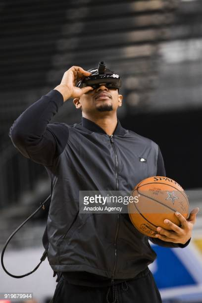 Bradley Beal of Team Lebron demos a Verizon 5G virtual reality headset after AllStar Practice as part of NBA AllStar Weekend at the Convention Center...