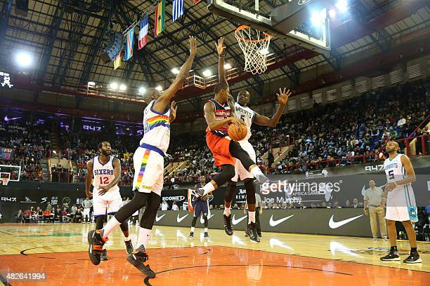 Bradley Beal of Team World passes against Gorgui Dieng of Team Africa during the NBA Africa Game 2015 as part of Basketball Without Boarders on...