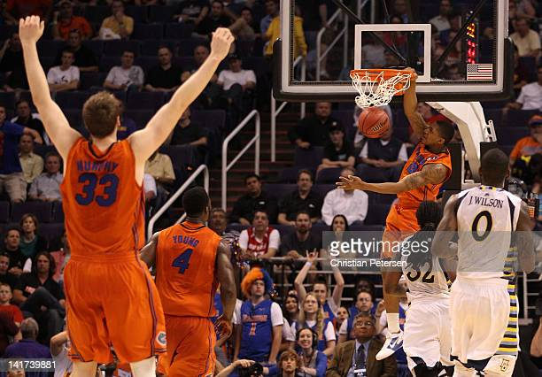 Bradley Beal of the Florida Gators dunks the ball as Erik Murphy celebrates while taking on the Marquette Golden Eagles during the 2012 NCAA Men's...