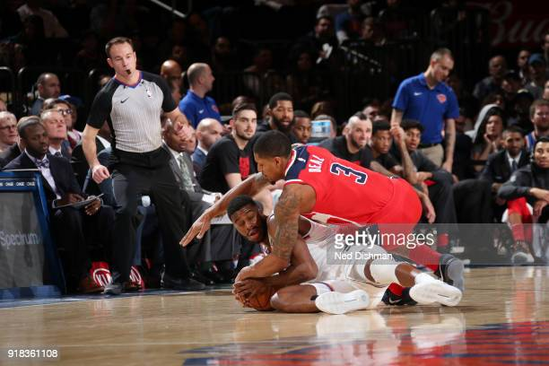 Bradley Beal of the Washington Wizards and Emmanuel Mudiay of the New York Knicks go for the loose ball on February 14 2018 at Madison Square Garden...