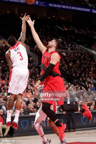 Bradley Beal of the Washington Wizards and Jusuf Nurkic of the Portland Trail Blazers go for the ball during the game on December 5 2017 at the Moda...