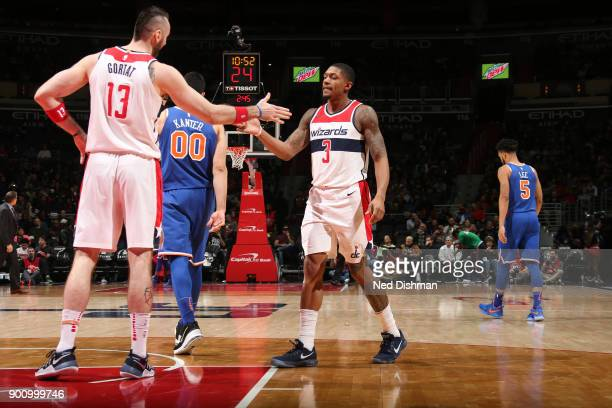 Bradley Beal of the Washington Wizards and Marcin Gortat of the Washington Wizards high five during the game against the New York Knicks on January 3...