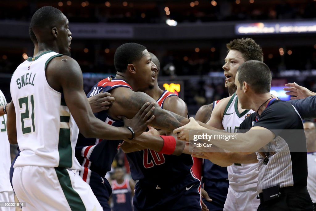 Bradley Beal #3 of the Washington Wizards and Matthew Dellavedova #8 of the Milwaukee Bucks are separated after Dellavedova fouled Beal and ejected in the second half at Capital One Arena on January 6, 2018 in Washington, DC.