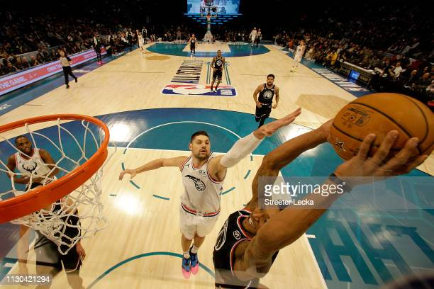 Bradley Beal of the Washington Wizards and Team LeBron shoots against Nikola Vučević of the Orlando Magic and Team Giannis during the NBA AllStar...