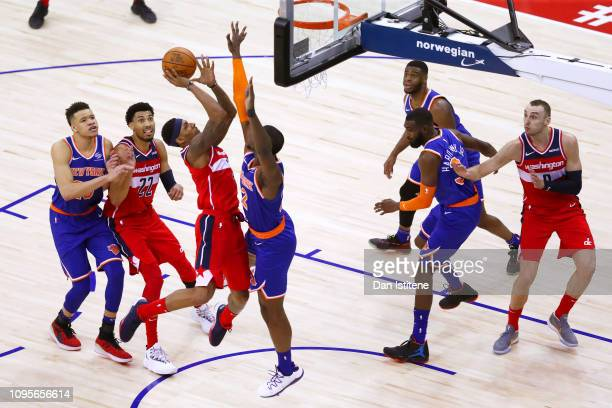 Bradley Beal of the Washington Wizards attempts to shoot under pressure from Noah Vonleh of the New York Knicks during the NBA London Game 2019...
