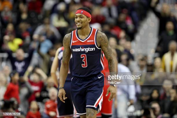 Bradley Beal of the Washington Wizards celebrates after hitting a shot in regulation against the Toronto Raptors at Capital One Arena on January 13...