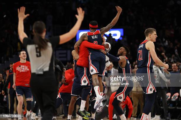 Bradley Beal of the Washington Wizards celebrates with teammates after scoring the gamewinning basket in front of Delon Wright of the Dallas...