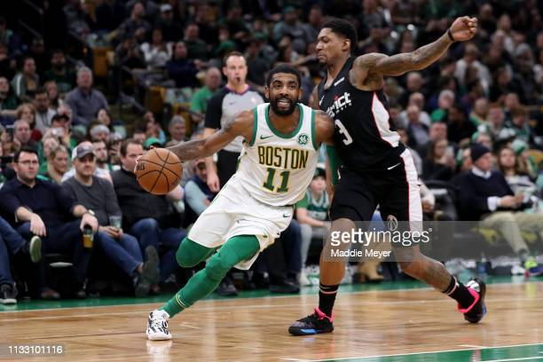 Bradley Beal of the Washington Wizards defends Kyrie Irving of the Boston Celtics during the second half at TD Garden on March 01 2019 in Boston...