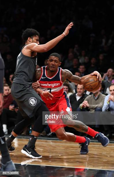Bradley Beal of the Washington Wizards dribbles against Spencer Dinwiddie of the Brooklyn Nets during their game at Barclays Center on December 12...