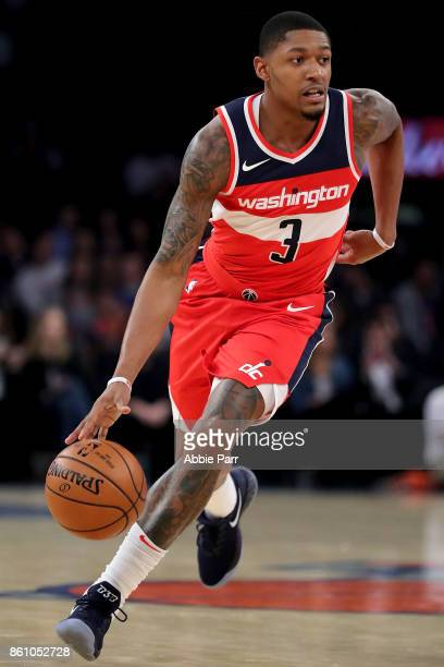 Bradley Beal of the Washington Wizards dribbles down the court against the New York Knicks during their Pre Season game at Madison Square Garden on...