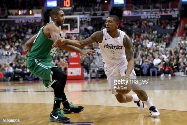 Bradley Beal of the Washington Wizards drives around Al Horford of the Boston Celtics in the first half at Capital One Arena on February 8 2018 in...