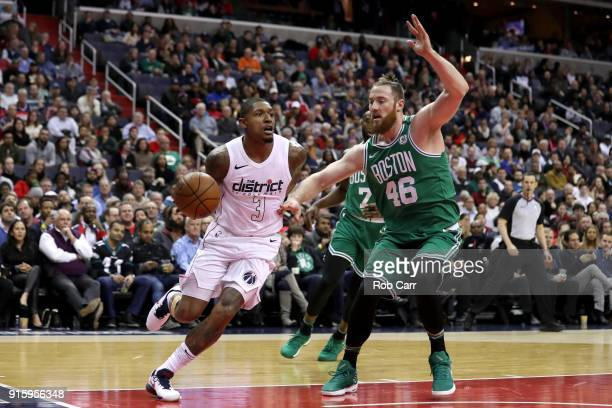 Bradley Beal of the Washington Wizards drives around Aron Baynes of the Boston Celtics in the first half at Capital One Arena on February 8 2018 in...