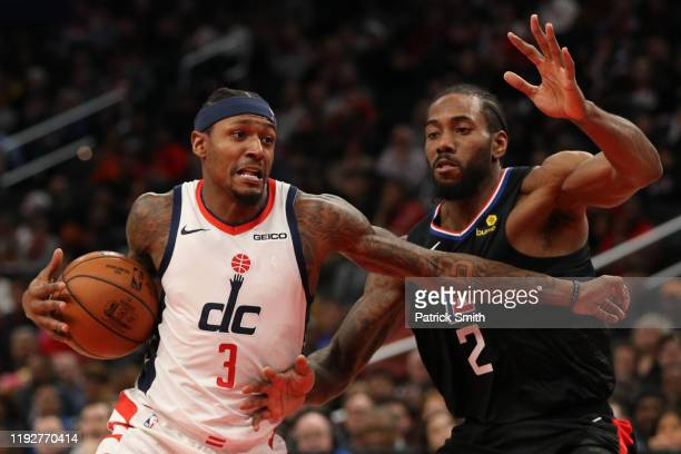 Bradley Beal of the Washington Wizards drives in the lane past Kawhi Leonard of the Los Angeles Clippers during the second half at Capital One Arena...