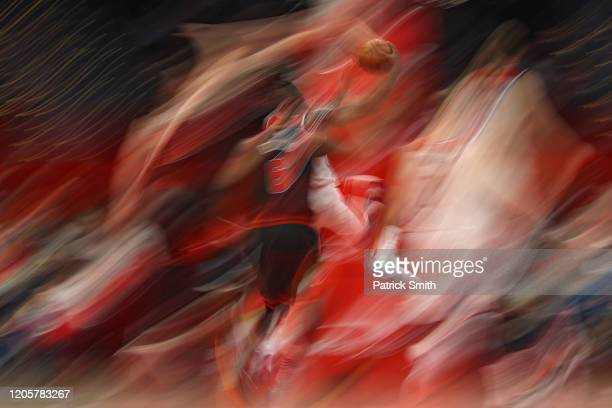 Bradley Beal of the Washington Wizards drives in the lane past Cristiano Felicio of the Chicago Bulls during the first half at Capital One Arena on...